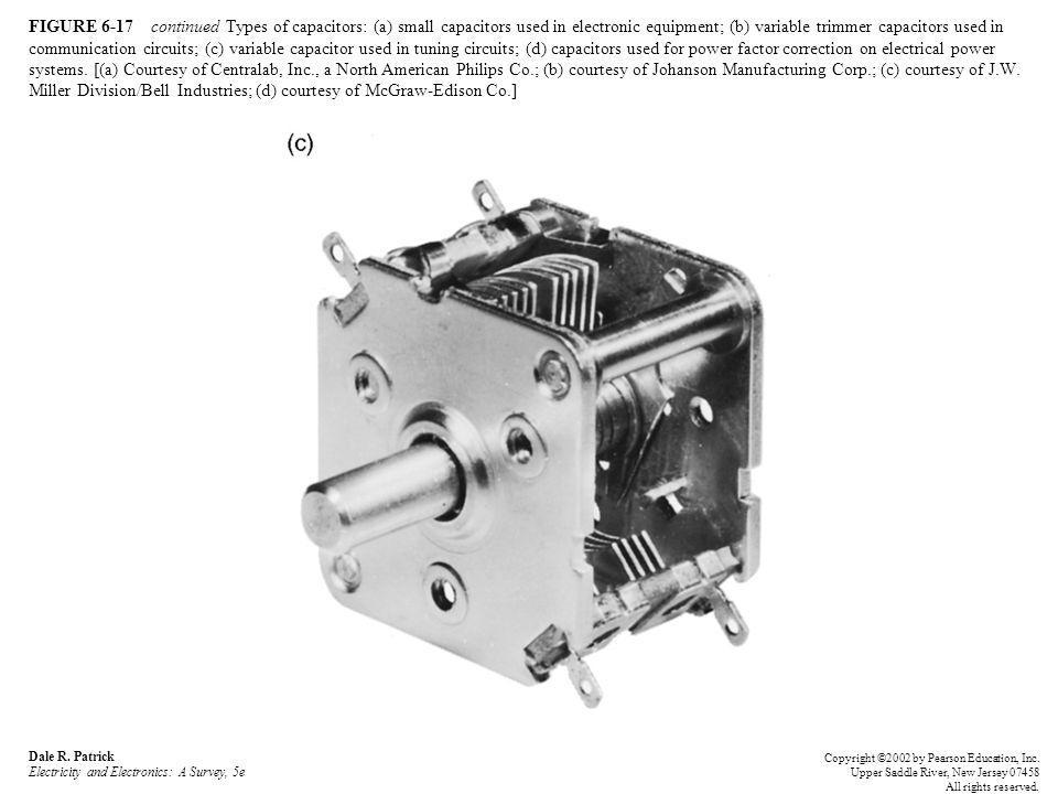 FIGURE 6-17 continued Types of capacitors: (a) small capacitors used in electronic equipment; (b) variable trimmer capacitors used in communication circuits; (c) variable capacitor used in tuning circuits; (d) capacitors used for power factor correction on electrical power systems. [(a) Courtesy of Centralab, Inc., a North American Philips Co.; (b) courtesy of Johanson Manufacturing Corp.; (c) courtesy of J.W. Miller Division/Bell Industries; (d) courtesy of McGraw-Edison Co.]